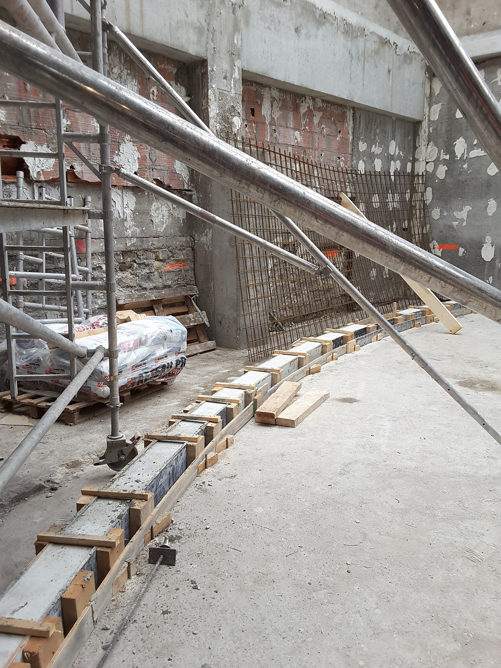 The masonry base for the new curved wooden structure