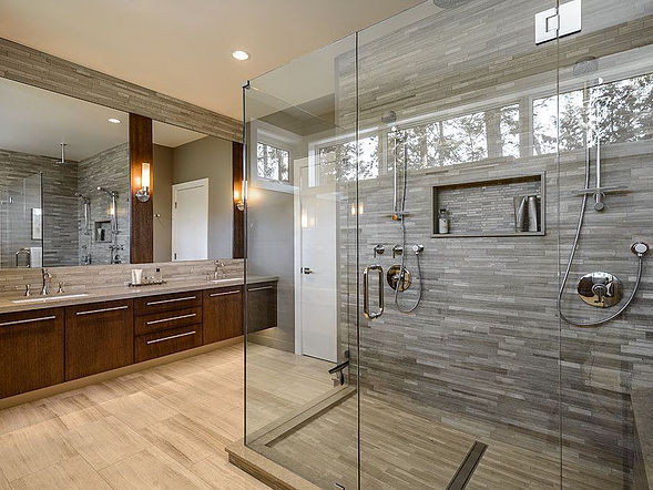 Frameless glass shower enclosure in stunning contemporary bathroom remodel