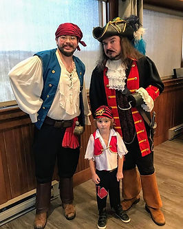 Captain Hook and Mister Smee with a youn