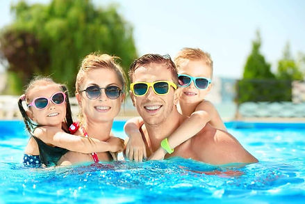 A-family-enjoying-a-swimming-pool.jpg