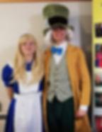 Alice & Hatter with banner.jpg
