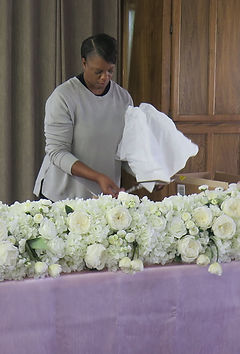 Janice arranges flowers.jpg