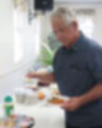 Eliah fills his plate.JPG