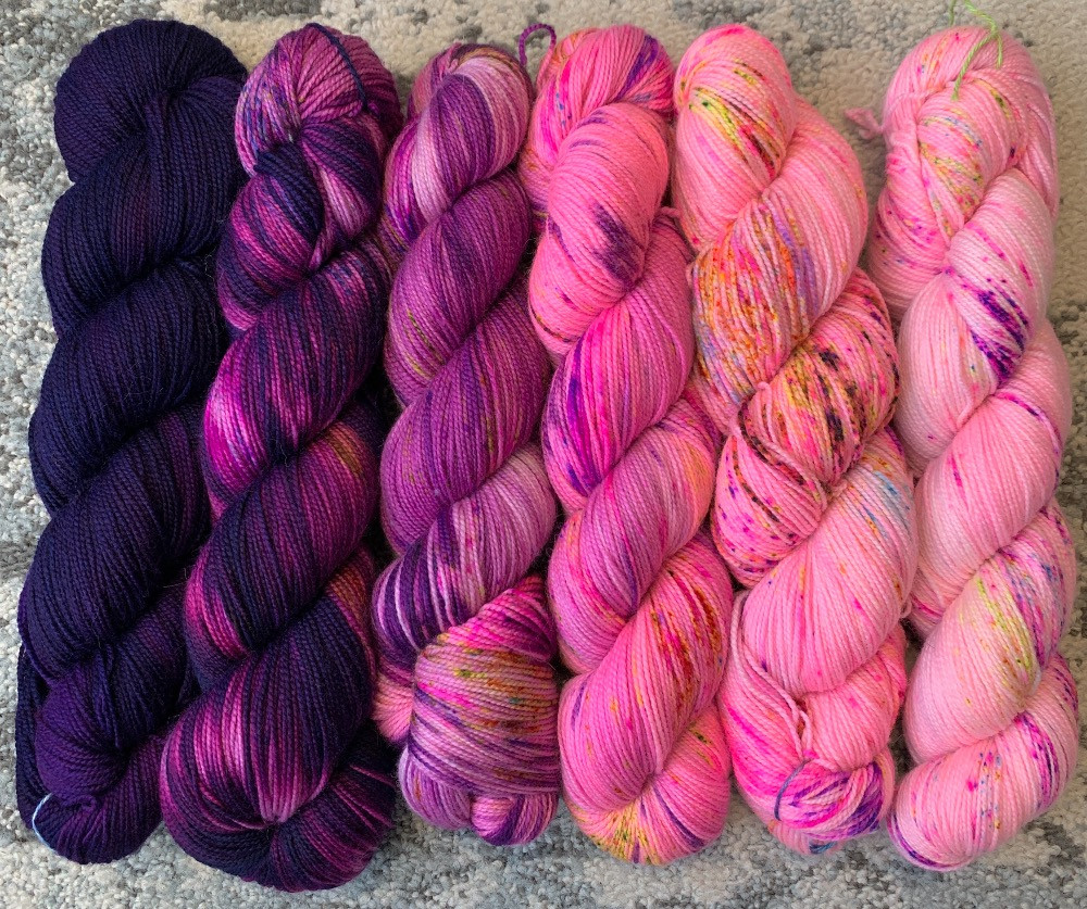 pictured: 6 skeins of hand dyed yarn, faded dark purple to light pink