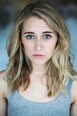 A headshot photo of Phoebe Stapleton