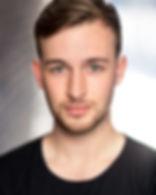 A headshot photo of Ed Theakston