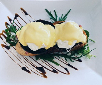 Portobello mushrooms served with hollandaise and poached eggs