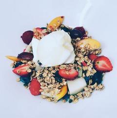 Fresh fruit served with granola, greek yoghurt and honey