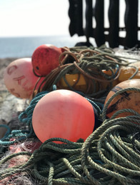 Crab pots and bouys on the working part of the beach