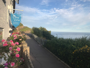 Bay View is surrounded by gardens, with the sea in front