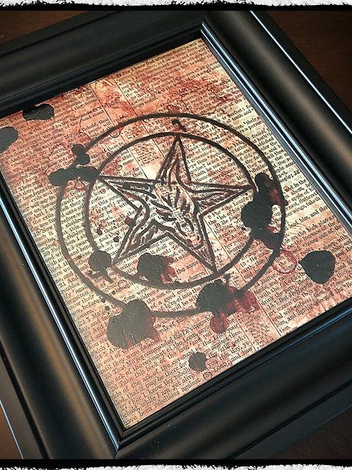 Framed real blood baphomet on vintage bible page.