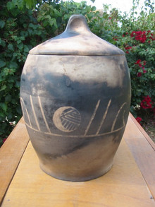 pit fired pot with moon ceramics