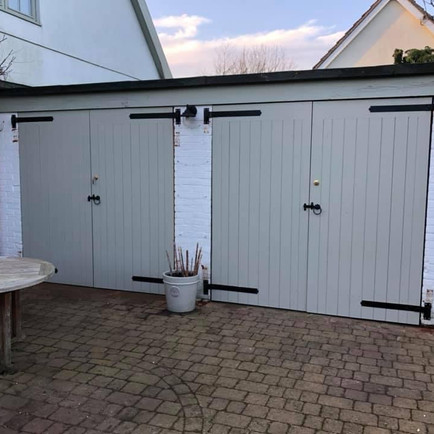 Two pairs of garage doors
