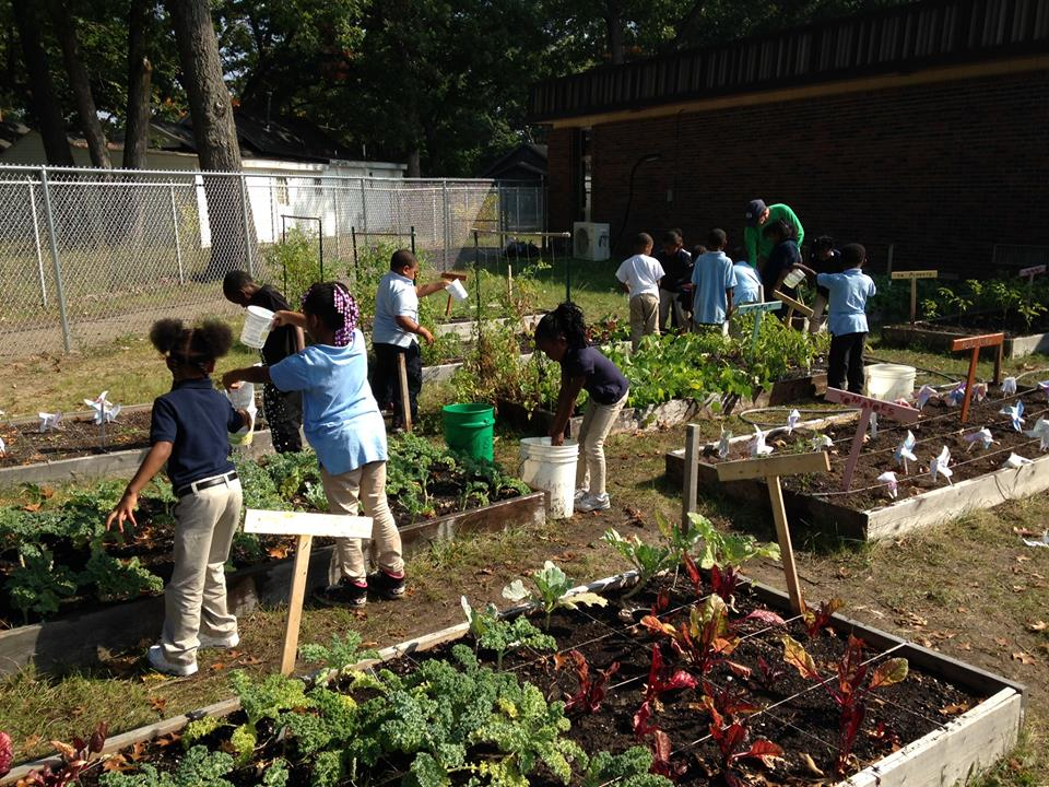 students watering garden 2014