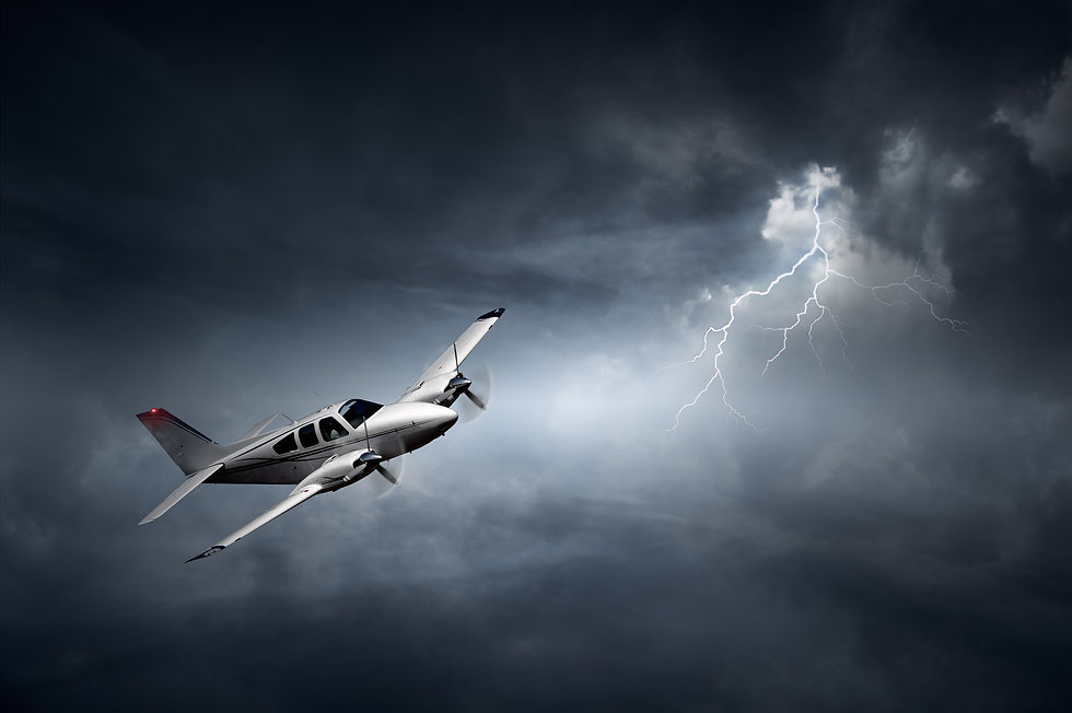 Airplane flying in storm with lightning.