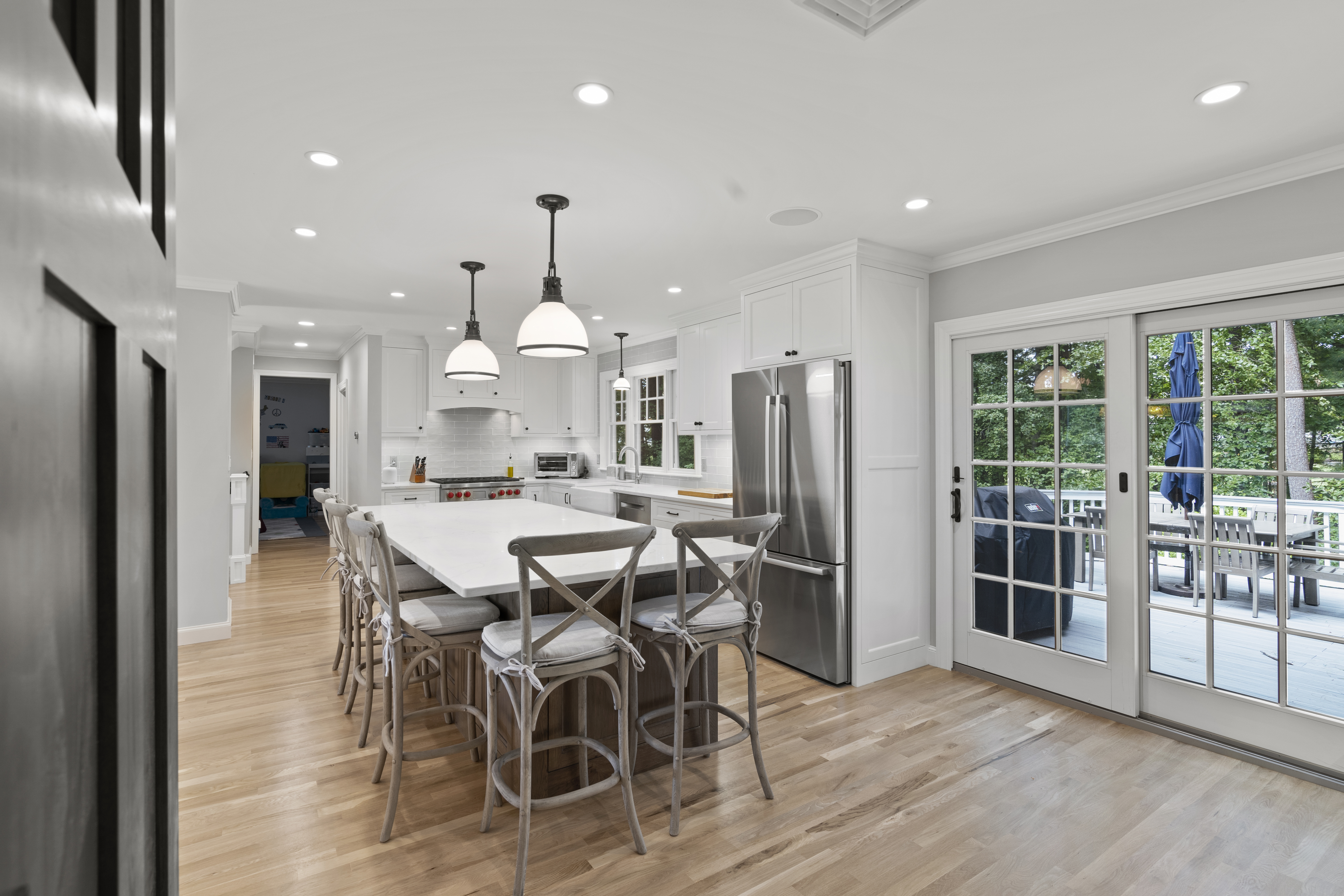 Beautiful custom kitchen and dining area high-end editing real estate photography