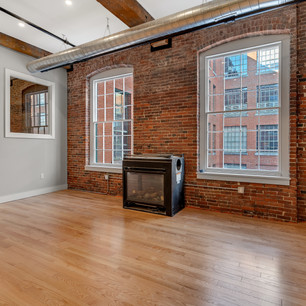 Gorgeous industrial condo renovation with brick walls photograph by Allard Media Group
