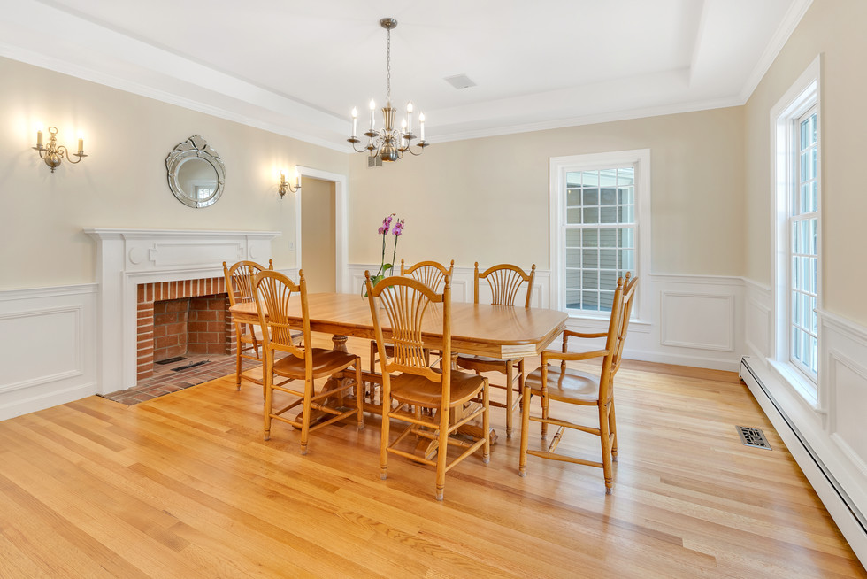 Spacious custom build dining room in real estate photograph by Allard Media Group
