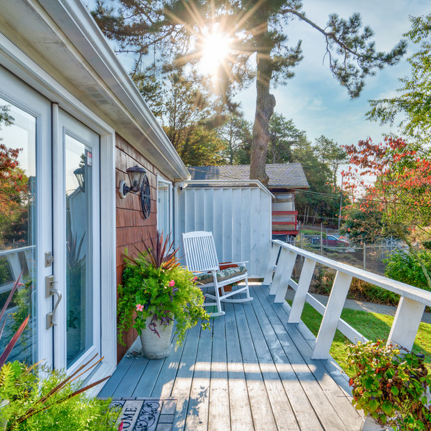 Beautiful porch with rocking chair and blue sky photography Allard Media Group