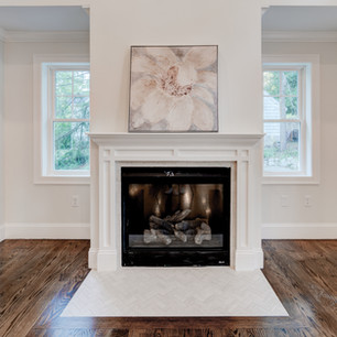 Beautiful custom spacious luxury mansion fireplace in dining area room real estate photography with editing shot by real estate photographer Allard Media Group