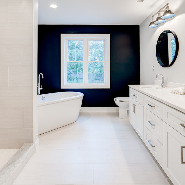 Beautifully crafted master bathroom in spacious luxury mansion with shower and bathtub real estate photography with editing shot by real estate photographer Allard Media Group