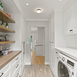 Custom pantry and laundry room in luxury home real estate photography with high-end editing shot by real estate photographer Allard Media Group