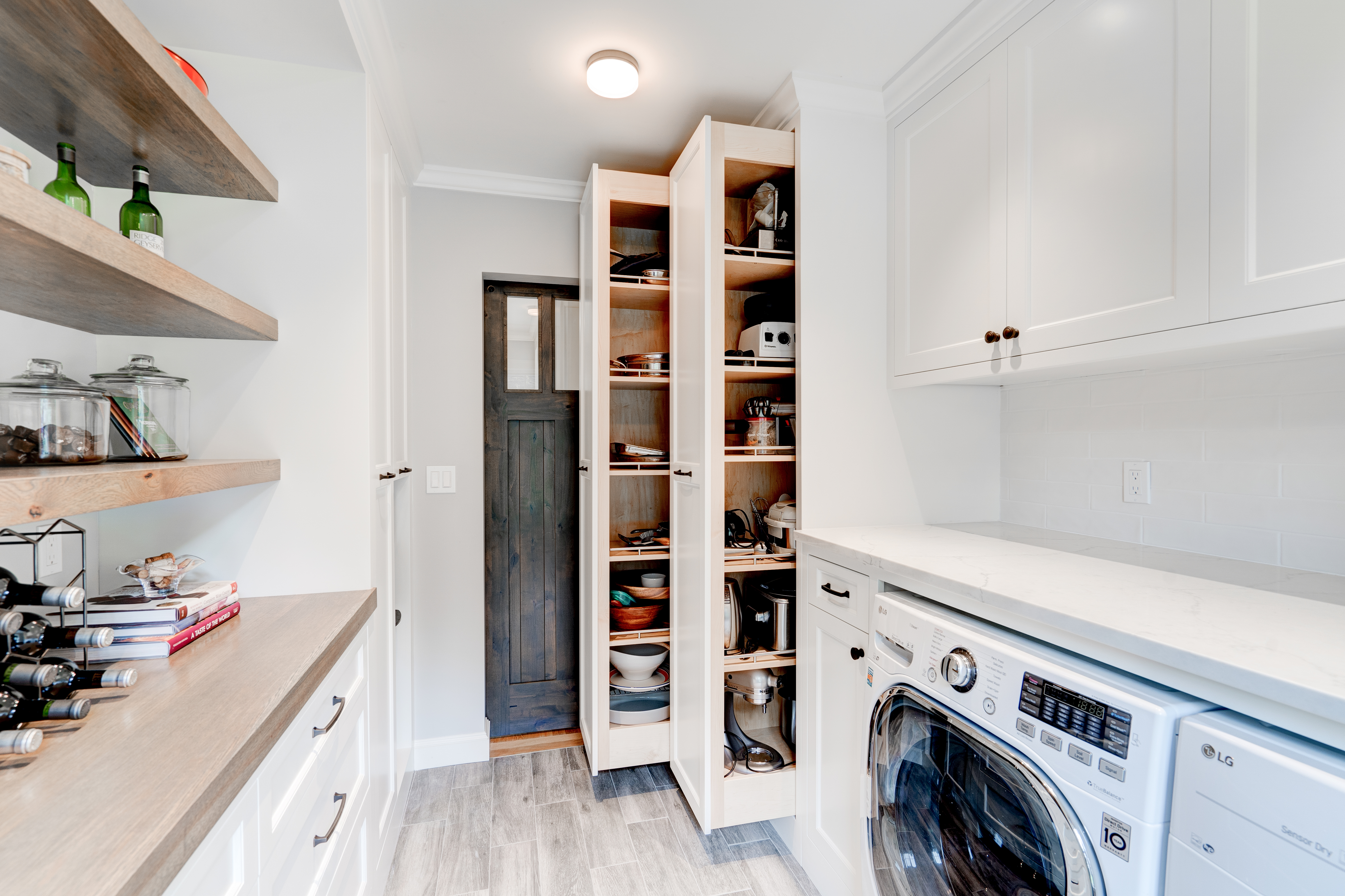 Custom laundry room and pantry real estate photography