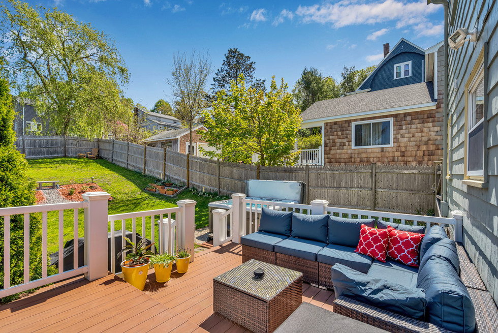 Gorgeous sunny deck with outdoor furniture in real estate photograph by Allard Media Group