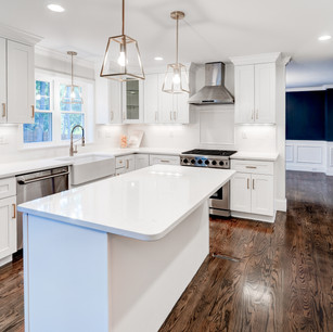 Beautiful custom kitchen in luxury mansion with lovely cabinets countertops and appliances real estate photography with editing shot by real estate photographer Allard Media Group