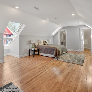 Lovely spacious master bedroom with hardwood floors and natural light skylights photograph by Allard Media Group