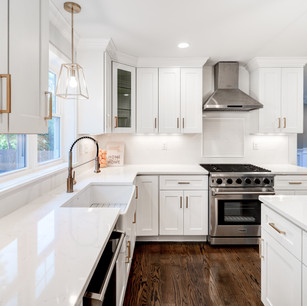 Beautiful custom kitchen in luxury mansion with lovely cabinets counters and appliances real estate photography with editing shot by real estate photographer Allard Media Group