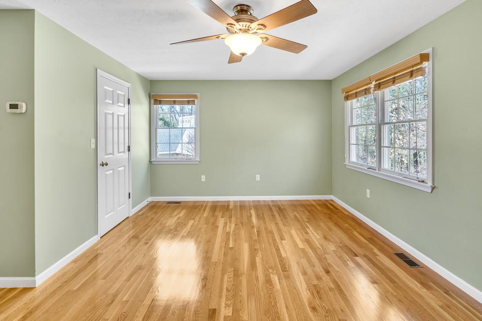 Beautiful master bedroom custom build in real estate photograph by Allard Media Group