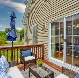 Beautiful deck and condo with sky replacement and editing real estate photography shot by real estate photographer Allard Media Group