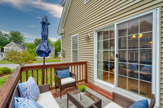 Beautiful deck and condo with wonderful landscape real estate photography shot by real estate photographer Allard Media Group