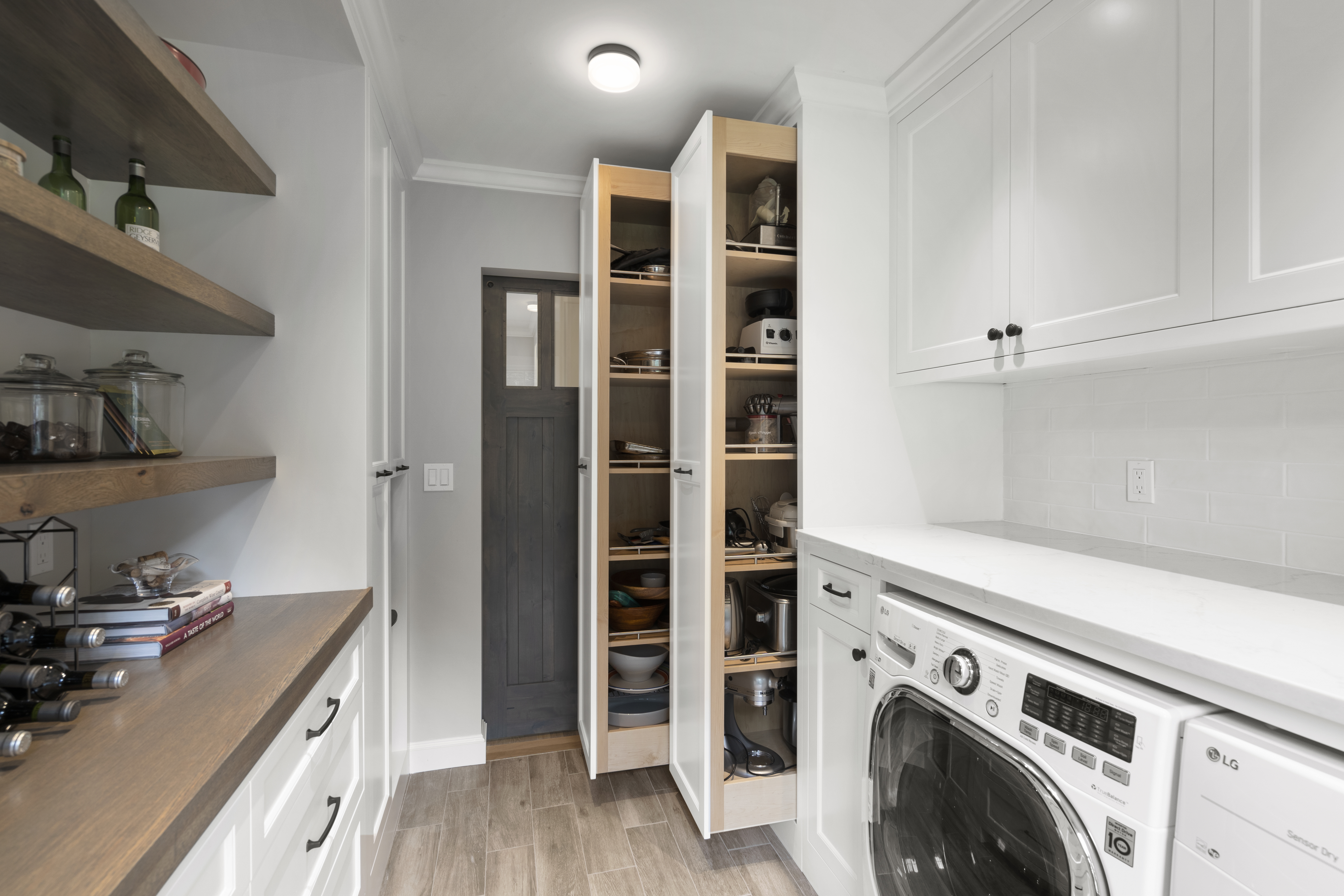 Beautiful custom pantry and laundry room high-end editing real estate photography