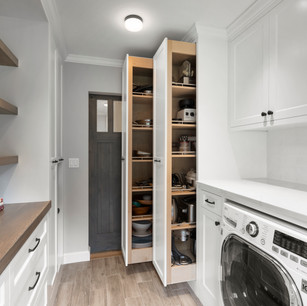 Custom pantry and laundry room in luxury home rreal estate photography with high-end editing shot by real estate photographer Allard Media Group