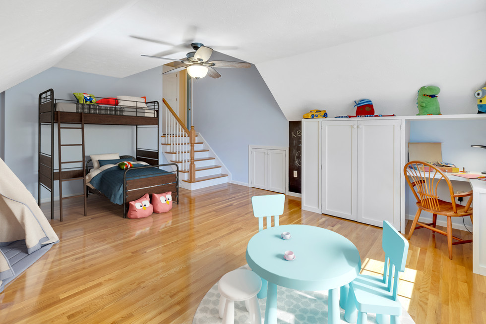 Virtually staged spacious playroom custom build in real estate photograph by Allard Media Group