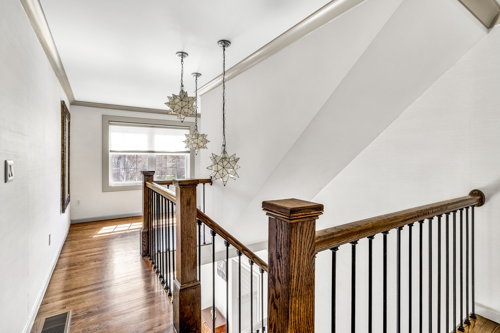 Beautiful custom build staircase in real estate photograph by Allard Media Group