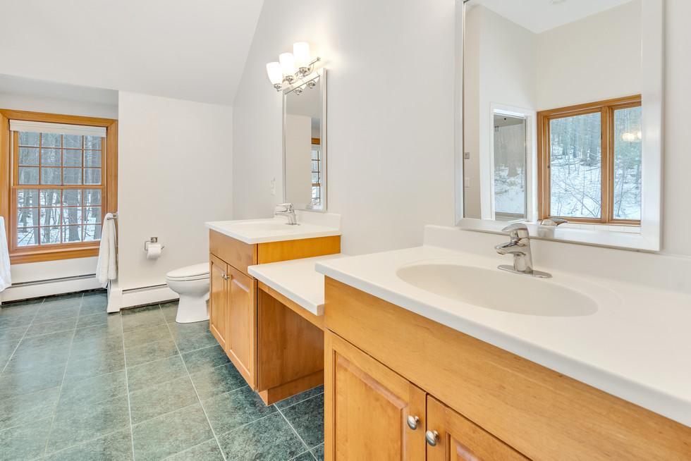 Spacious tiled master bathroom custom build in real estate photograph by Allard Media Group