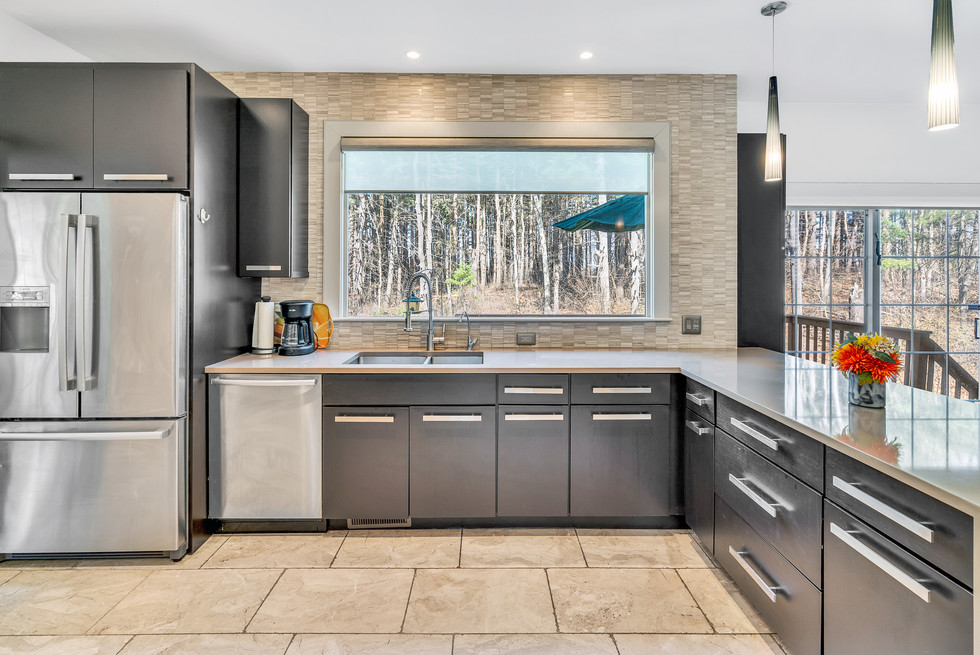 Spacious custom build modern kitchen in real estate photograph by Allard Media Group