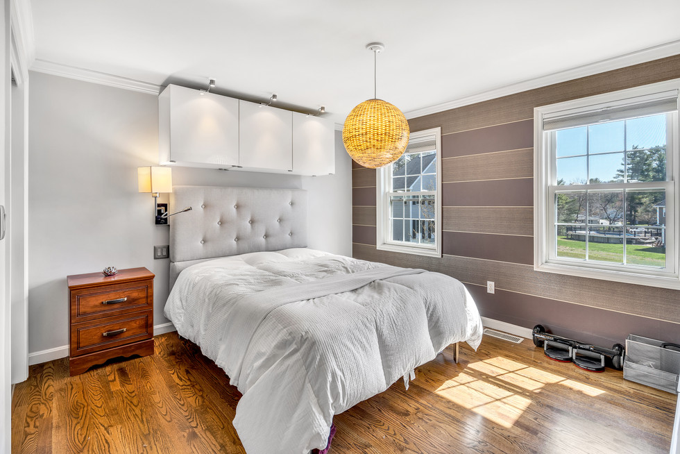 Gorgeous guest bedroom custom build in real estate photograph by Allard Media Group
