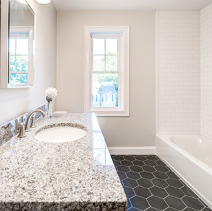 Beautiful custom bathroom with shower in luxury mansion real estate photography with editing shot by real estate photographer Allard Media Group