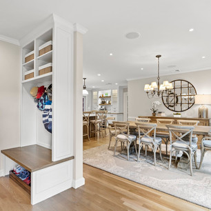 Custom eat-in kitchen dining room mudroom in luxury home real estate photography with high-end editing shot by real estate photographer Allard Media Group