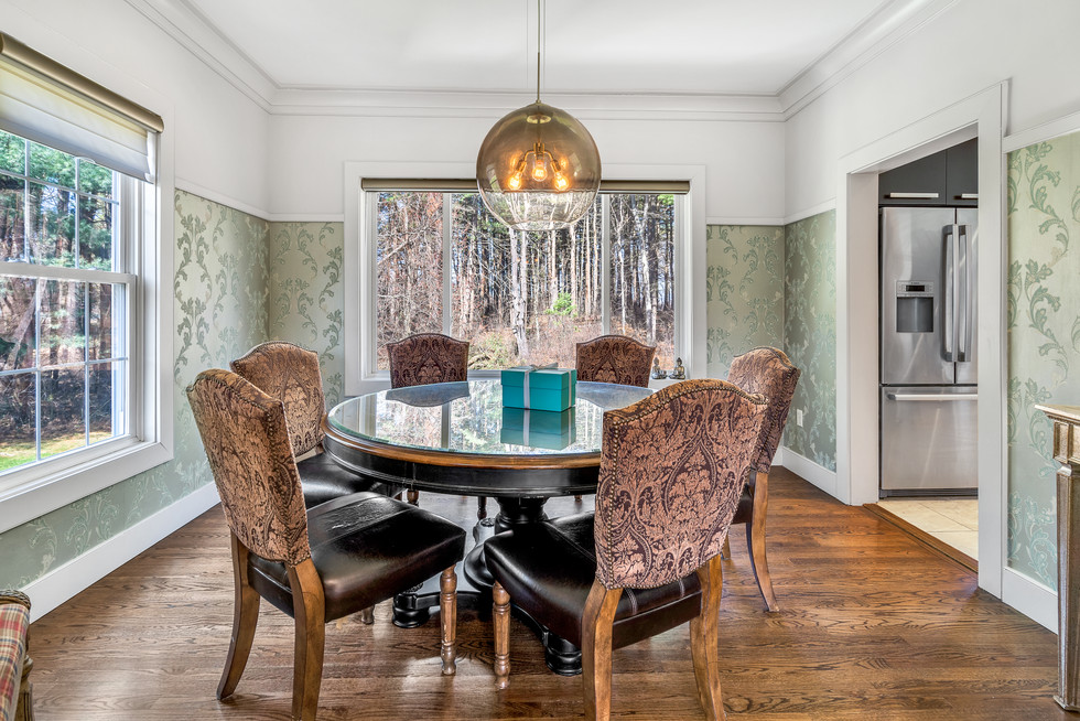 Gorgeous dining room with wallpaper custom build in real estate photograph by Allard Media Group
