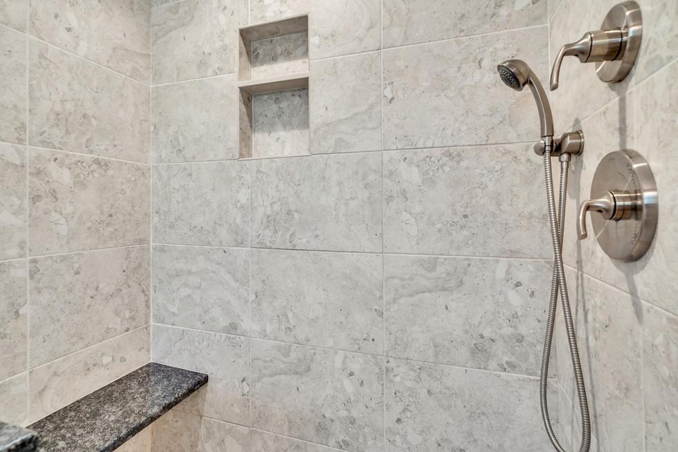 Beautiful master bathroom shower renovation custom build in real estate photograph by Allard Media Group