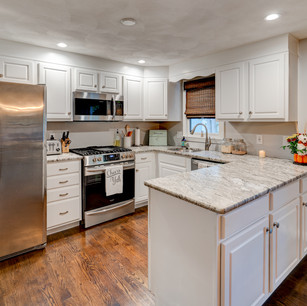 Beautifully appointed kitchen with lovely cabinets and counters in home flip real estate photography real estate photographer Allard Media Group