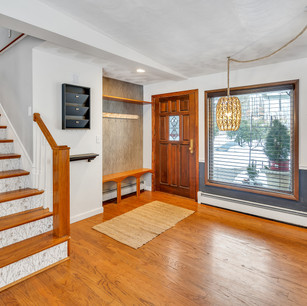 Gorgeous spacious entry way with natural light and hardwoods photograph by Allard Media Group