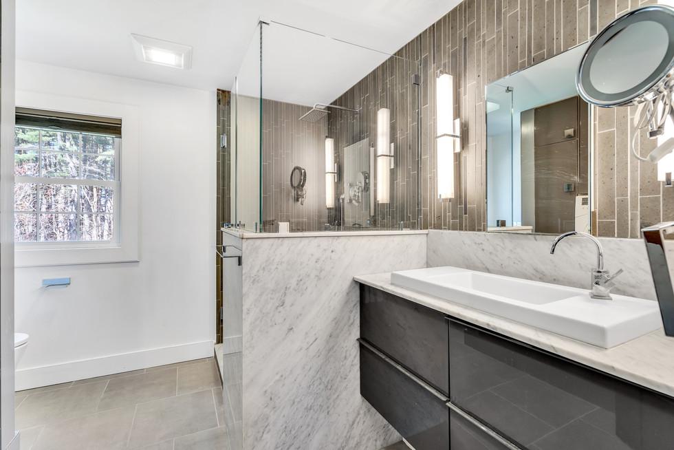 Spacious custom build master bathroom in real estate photograph by Allard Media Group