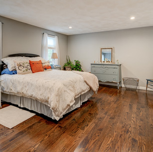 Lovely master bedroom with country chic accents in condo real estate photography Allard Media Group