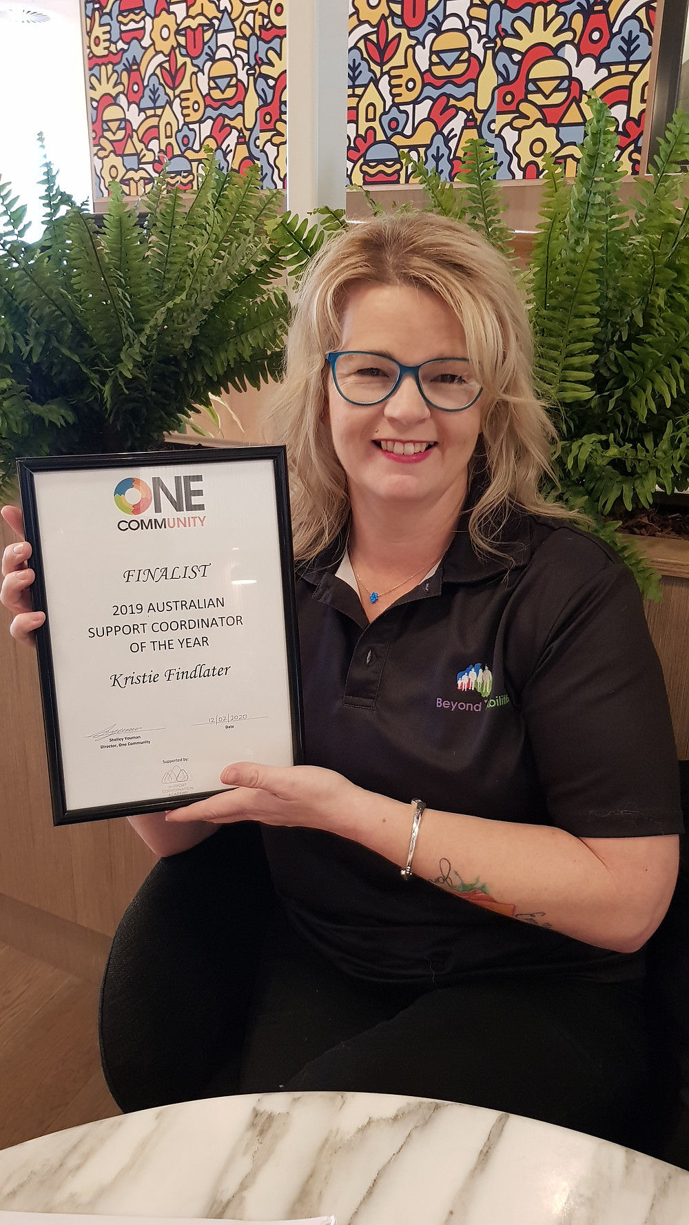 Beyond Abilities' support coordinator Kristie Findlater, proudly showing her 2019 Australian Support Coordinator of the Year Award.